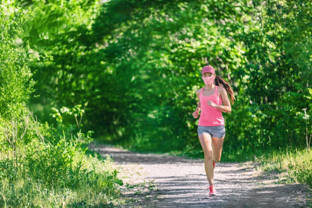 Mask corona virus COVID-19 running runner athlete wearing mask jogging