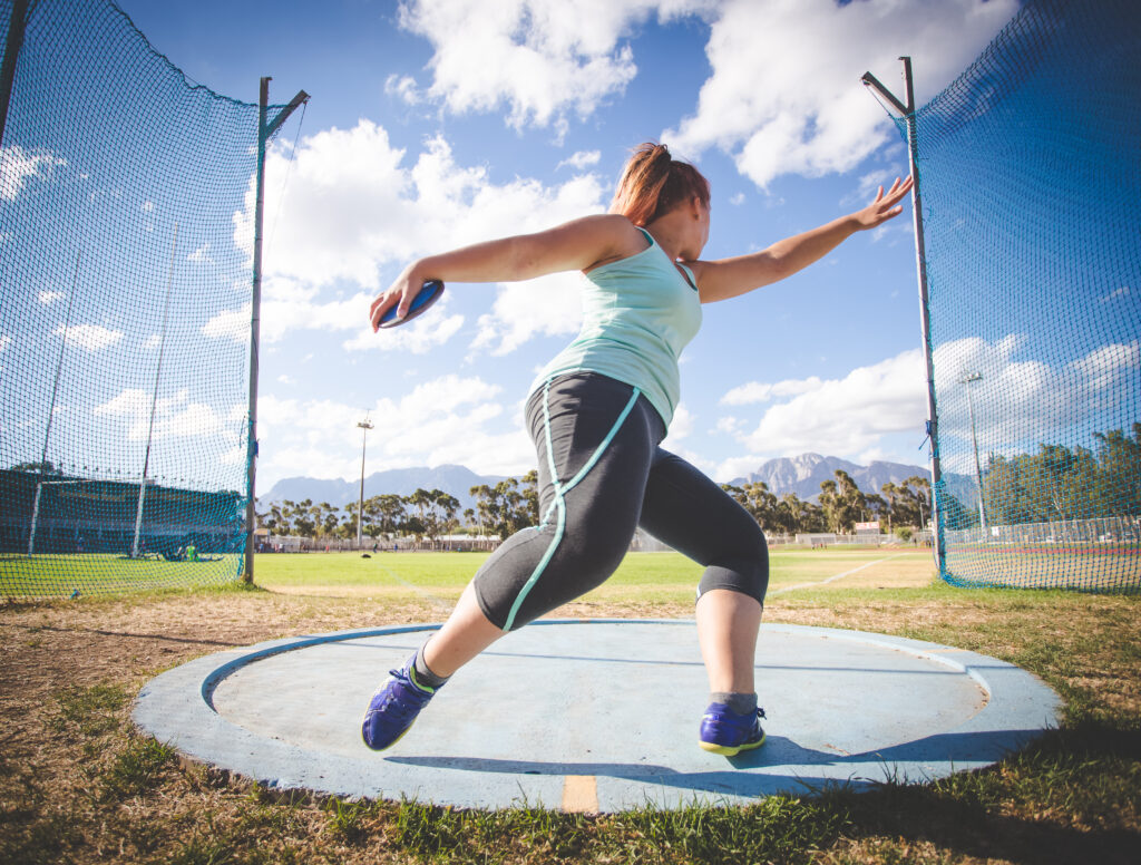 Female Athlete Throwing Discus